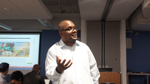 Marcus Harris, Build Social facilitator shares the COSTARTERS business model canvas with the crowd.